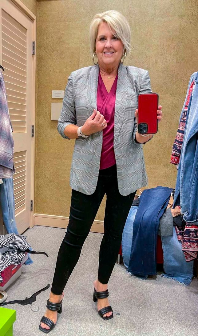 Fashion Blogger 50 Is Not Old is wearing a black check blazer, a deep pink blouse, and Spanx faux leather leggings and black heels from the Nordstrom Anniversary Sale