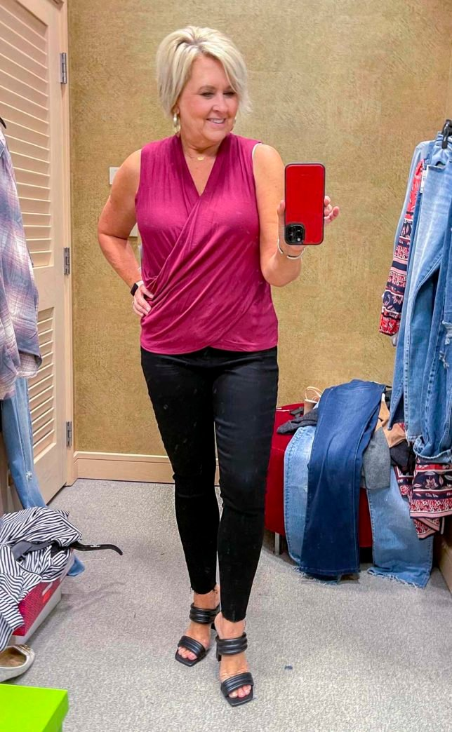 Fashion Blogger 50 Is Not Old is wearing a deep pink blouse with Spanx faux leather leggings and black heels from the Nordstrom Anniversary Sale