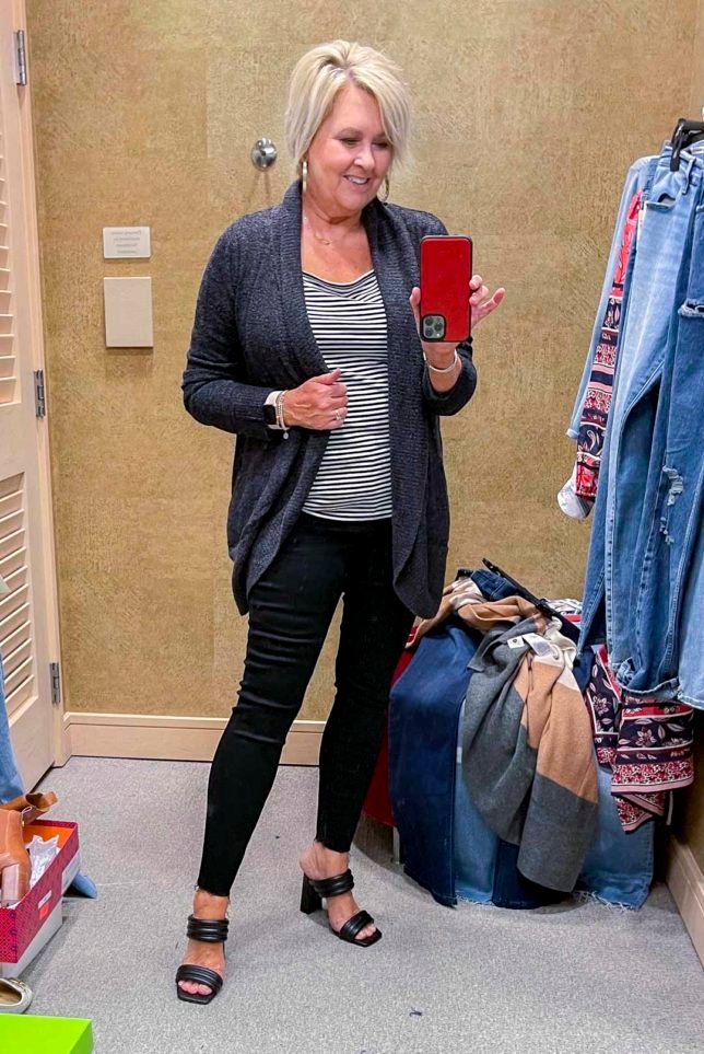 Fashion Blogger 50 Is Not Old is wearing a charcoal circle cardigan, a black and white tee, and black skinny jeans and black heels from the Nordstrom Anniversary Sale