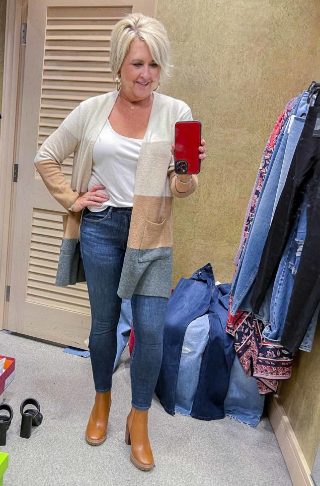 Fashion Blogger 50 Is Not Old is wearing a colorblock cardigan, a white tee, with skinny jeans and Tory Butch Lug Sole boots from the Nordstrom Anniversary Sale