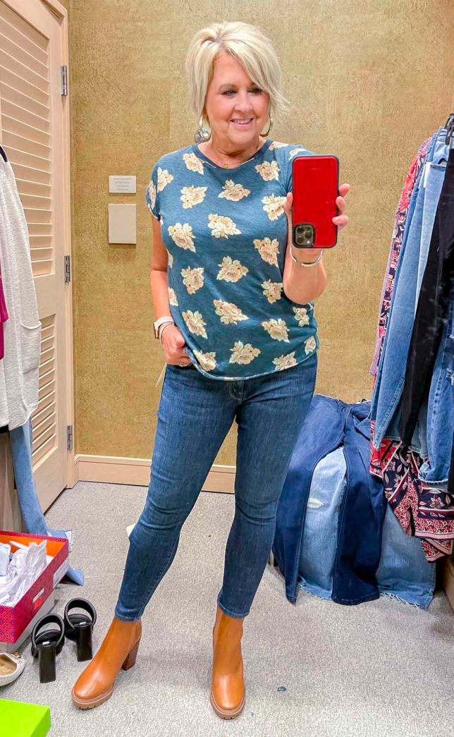 Fashion Blogger 50 Is Not Old is wearing a floral tee with skinny jeans and Tory Butch Lug Sole boots from the Nordstrom Anniversary Sale