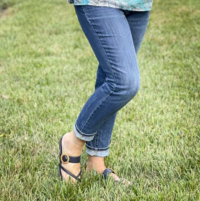 Fashion Blogger 50 Is Not Old is wearing a pair of straight leg ankle jeans and navy sandals from Talbots