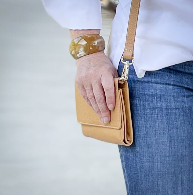 Over 40 Fashion Blogger, Tania Stephens, is wearing a cuff bracelet with a camel crossbody
