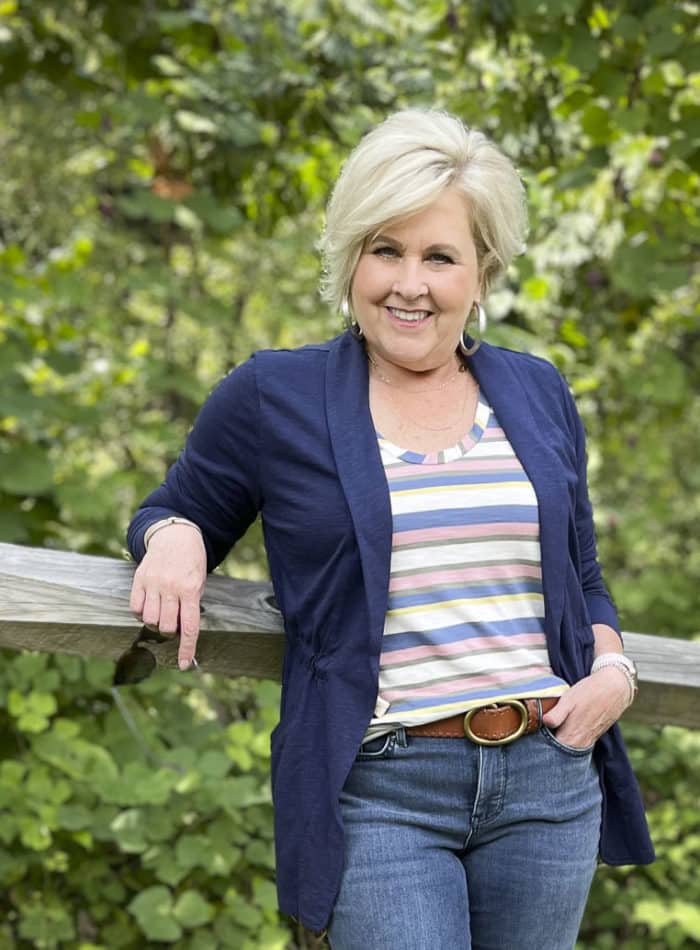 Fashion Blogger 50 Is Not Old is wearing a striped tank top with a navy cinched jacket