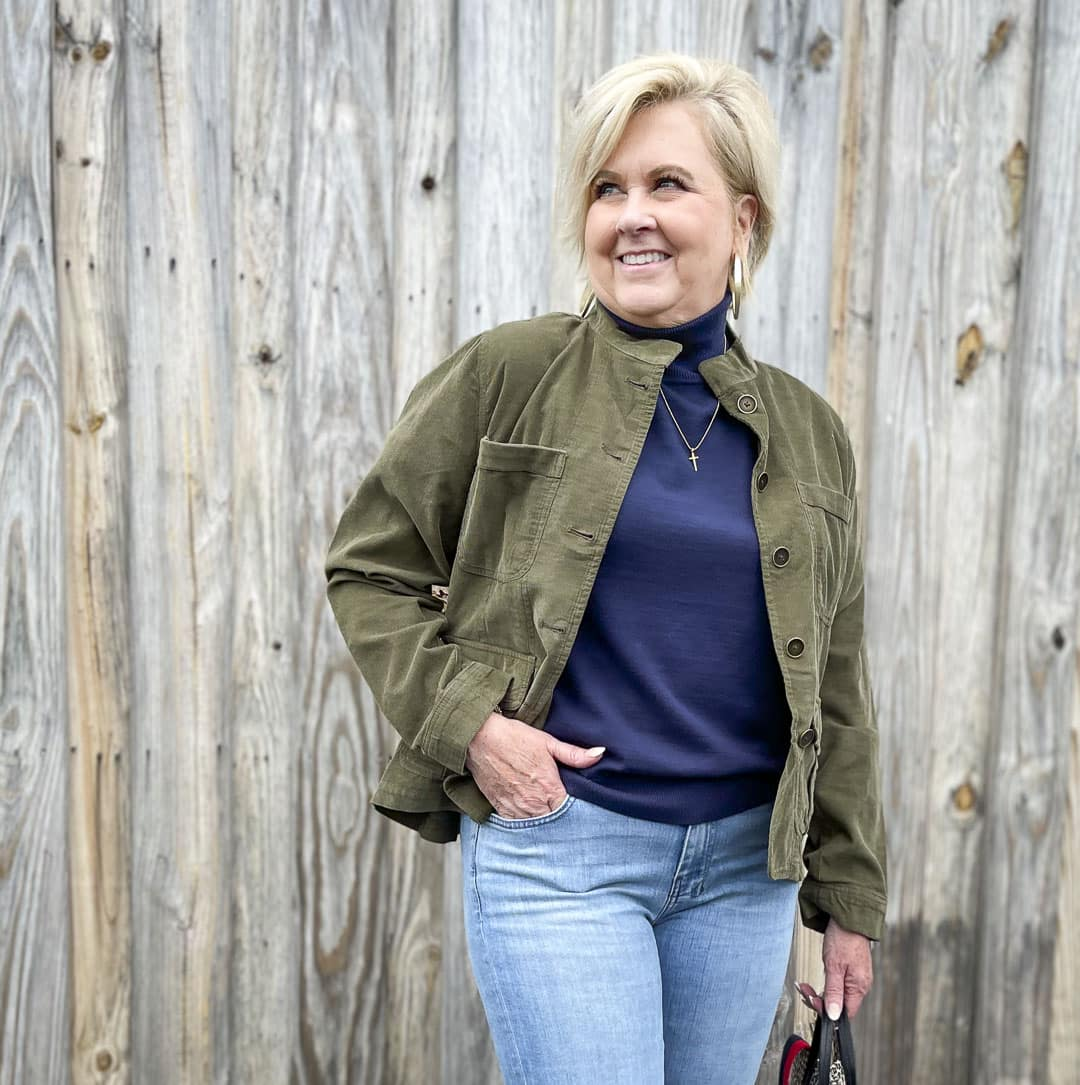 Over 40 Fashion Blogger, Tania Stephens, is wearing a olive corduroy jacket and a turtleneck sweater