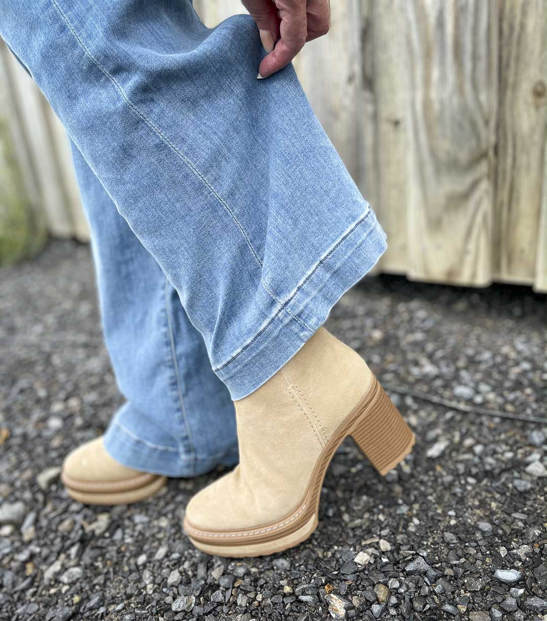 Over 40 Fashion Blogger, Tania Stephens, is wearing a pair of flare jeans and showing her Steve Madden platform boots