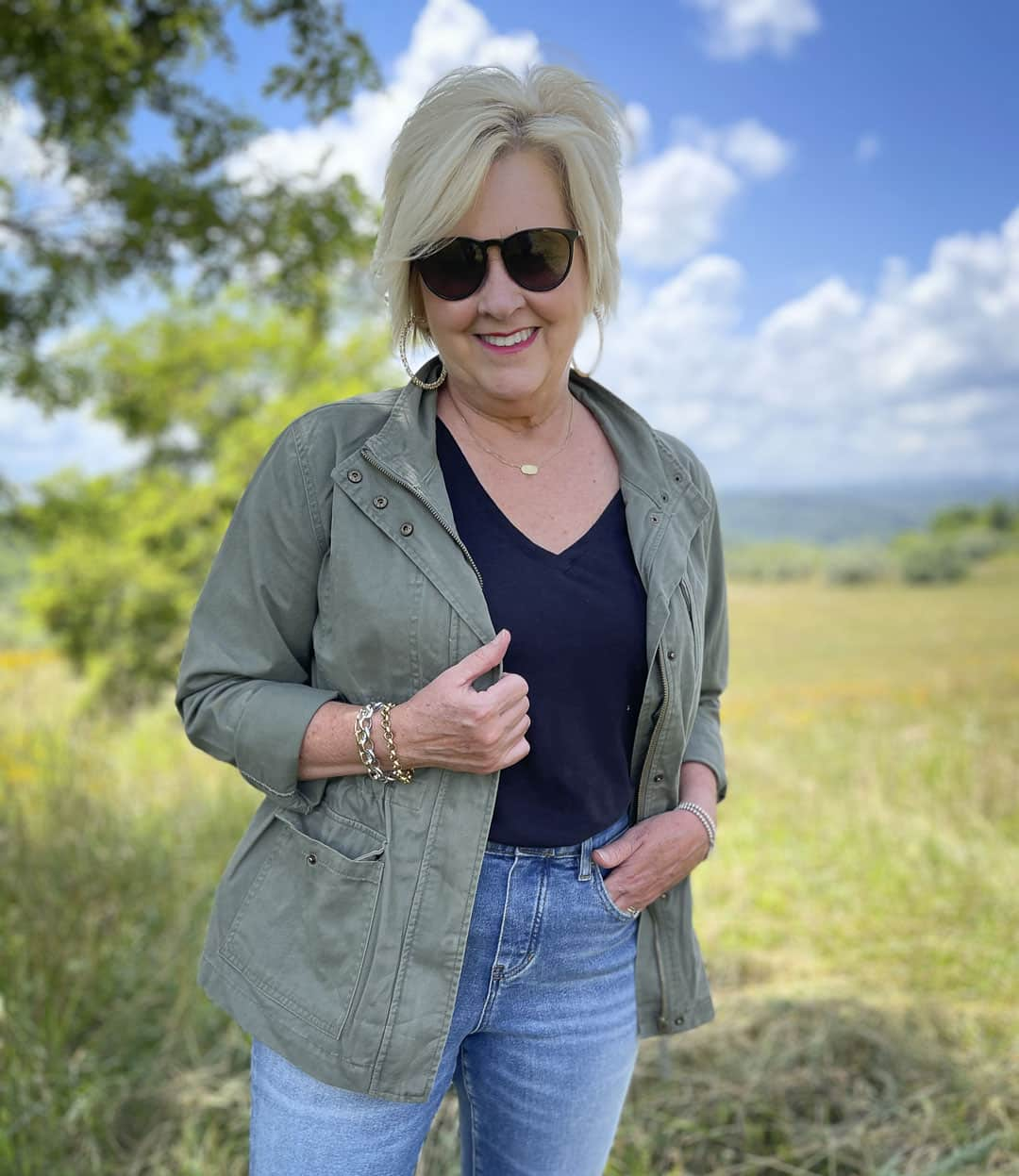 Fashion Blogger 50 Is Not Old is wearing a black tee and an olive jacket