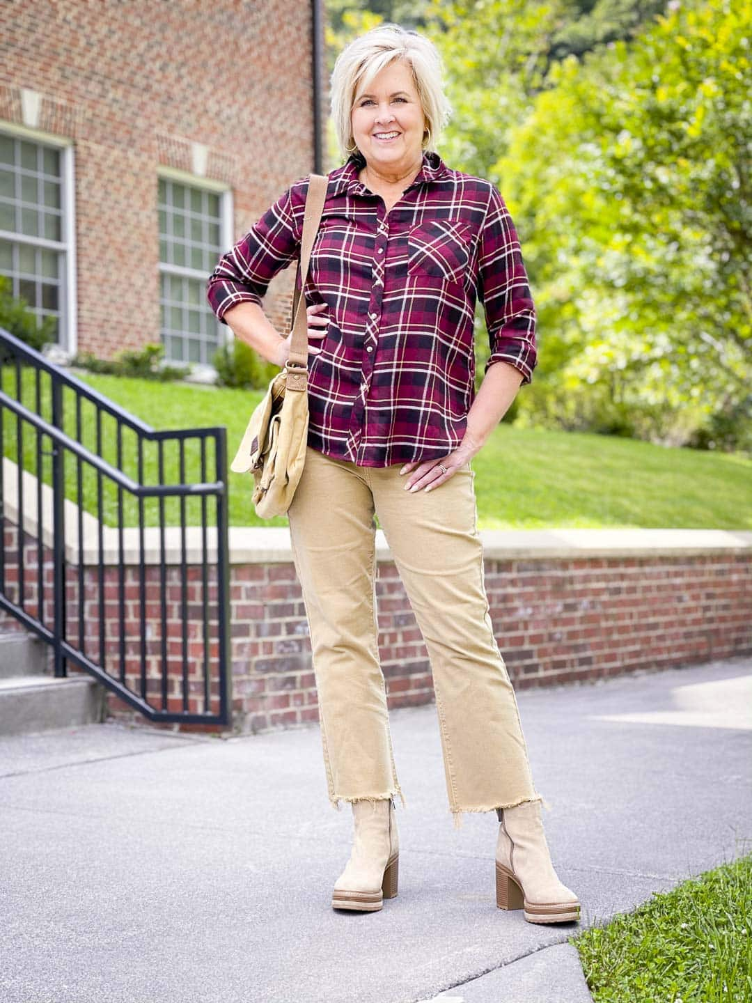 Over 40 Fashion Blogger, Tania Stephens is wearing a plaid flannel shirt with crop flare jeans to sho how to get the most out of your wardrobe