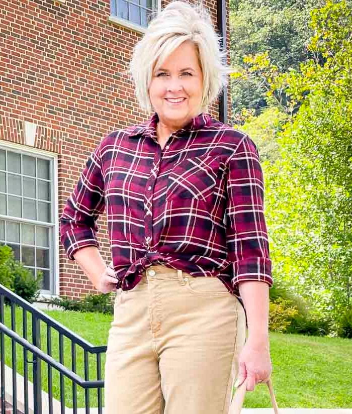 Over 40 Fashion Blogger, Tania Stephens is wearing a front tied plaid flannel shirt