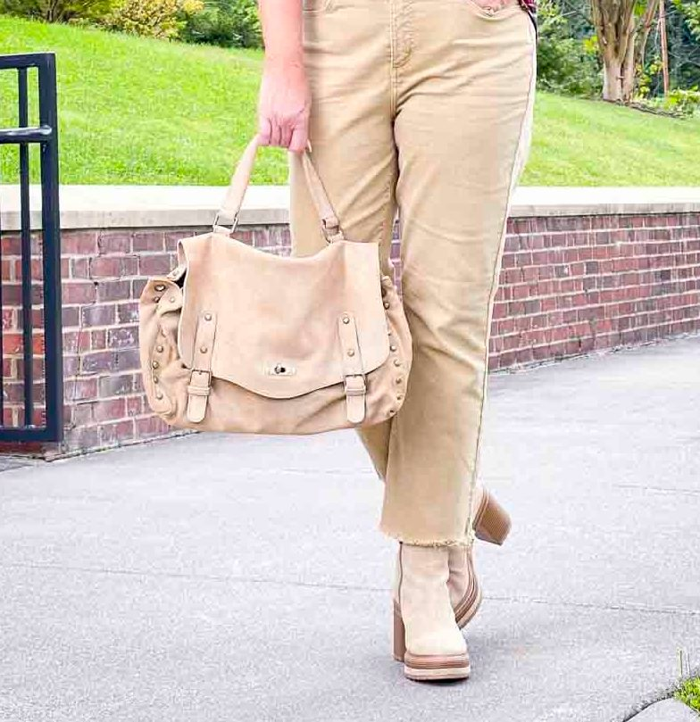 Over 40 Fashion Blogger, Tania Stephens is carrying a hobo messenger bag with crop jeans