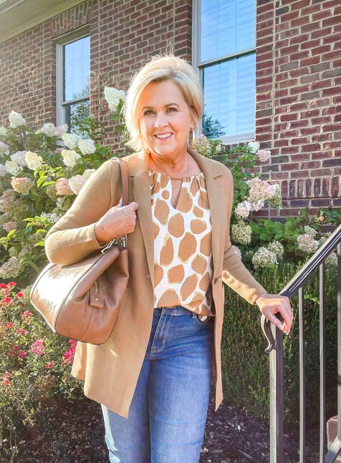Over 40 fashion blogger, Tania Stephens is wearing a tan printed top and sweater blazer