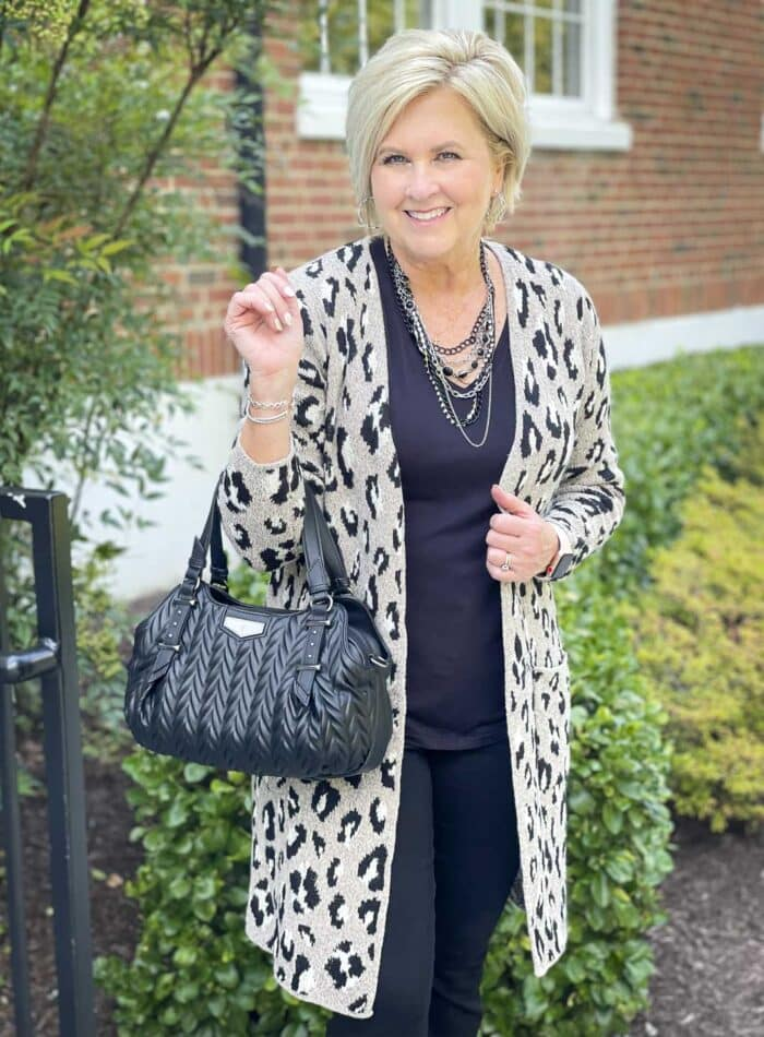 Over 40 Fashion Blogger, Tania Stephens is wearing a column of black with a cheetah print cardigan