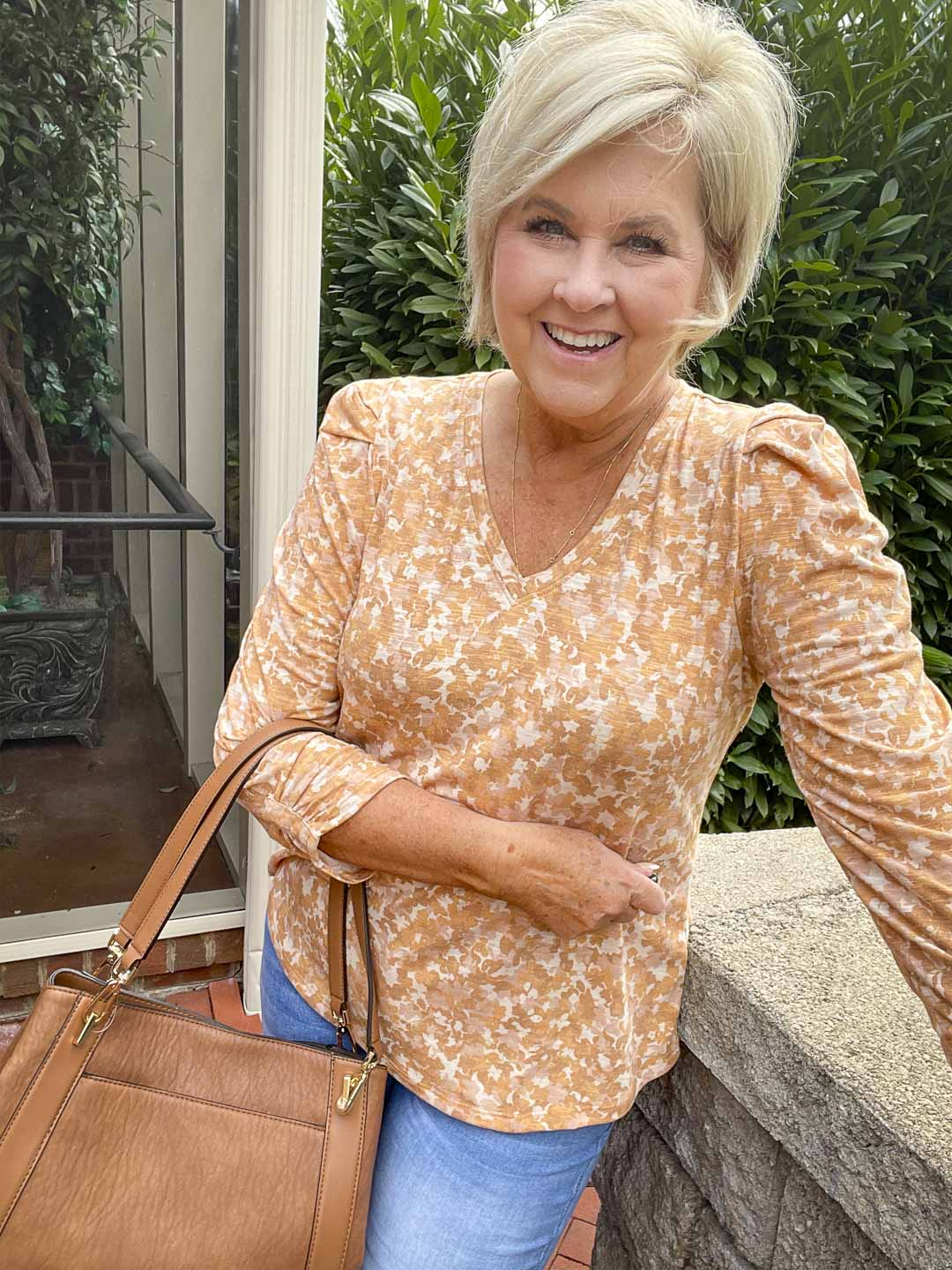 Over 40 Fashion Blogger, Tania Stephens, is wearing one of her puff sleeve tops