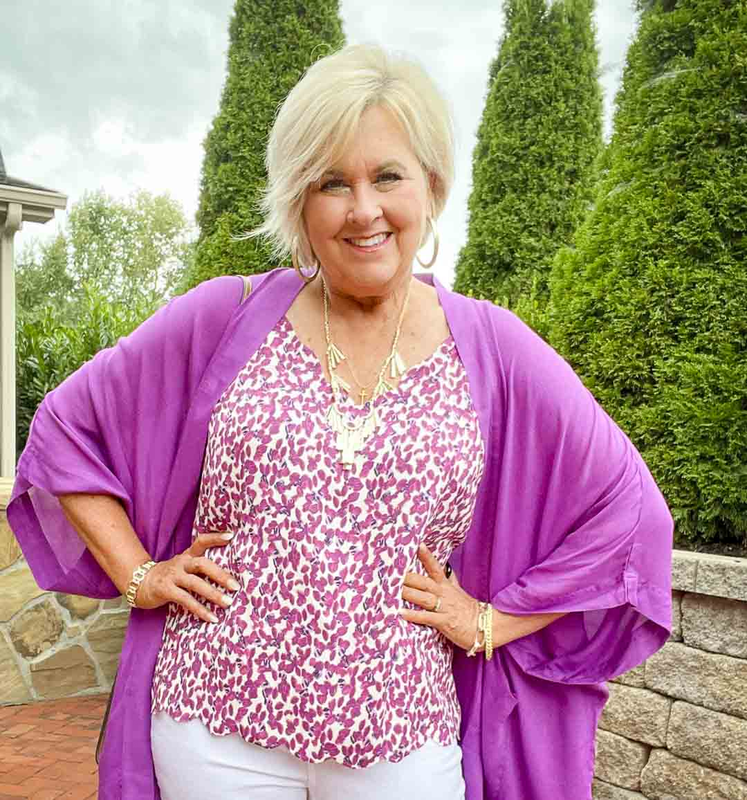 Over 40 fashion blogger, Tania Stephens is wearing a purple cardigan with a printed camisole