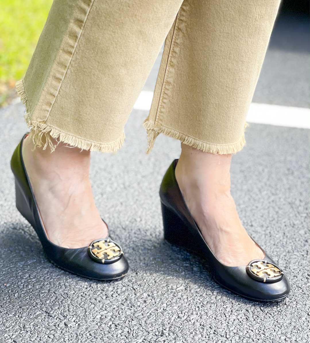 Over 40 Fashion Blogger, Tania Stephens is wearing raw hem jeans with Tory Burch wedge heels