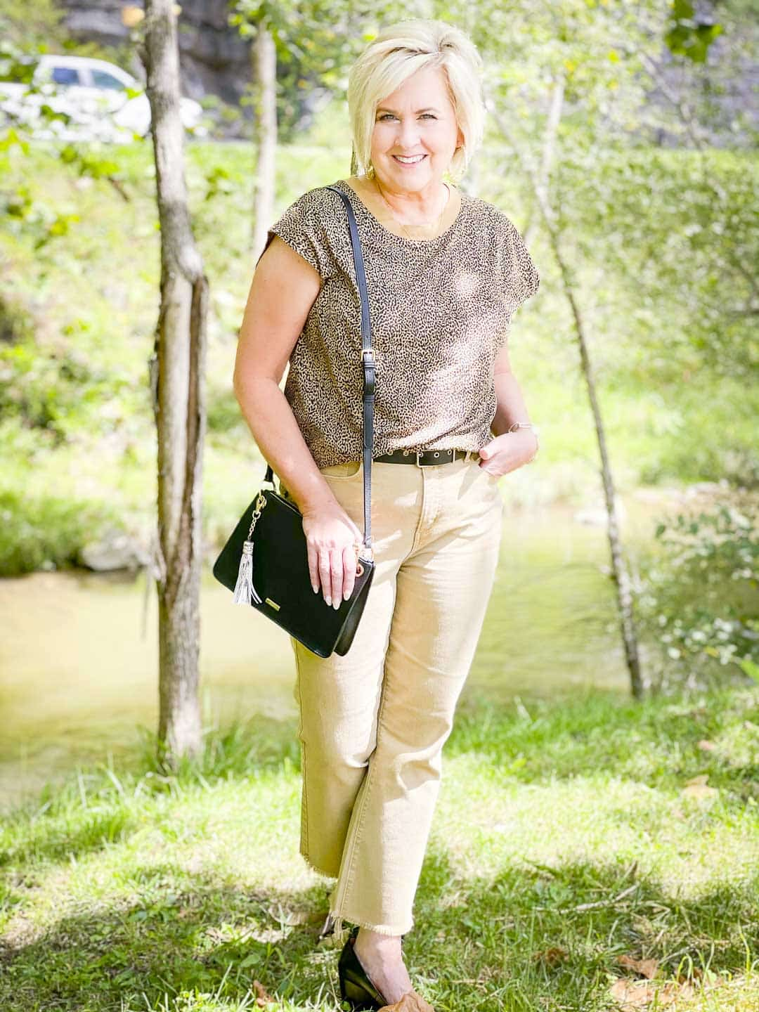 Over 40 Fashion Blogger, Tania Stephens is wearing animal print for fall, tan cropped jeans, and a black handbag