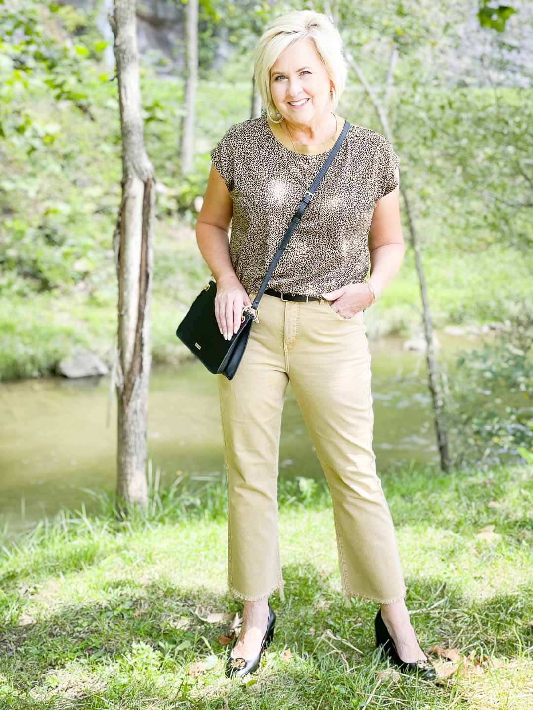 Over 40 Fashion Blogger, Tania Stephens is wearing animal print with tan cropped jeans for fall