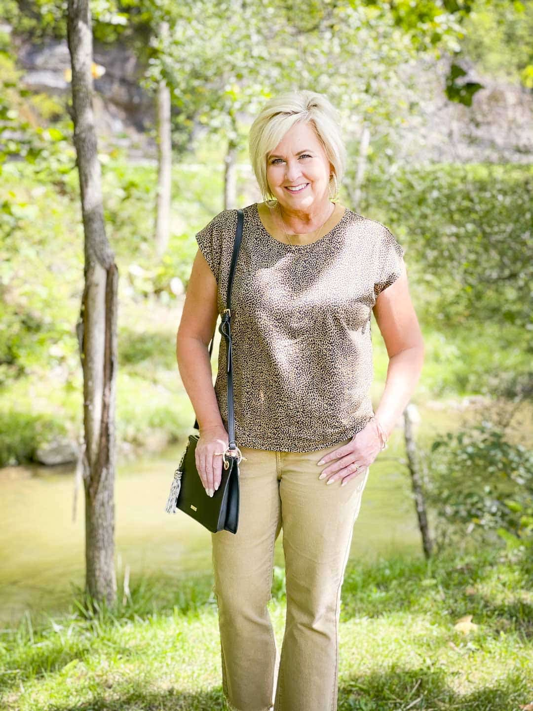 Over 40 Fashion Blogger, Tania Stephens is wearing animal print for fall, tan cropped jeans, and a black crossbody