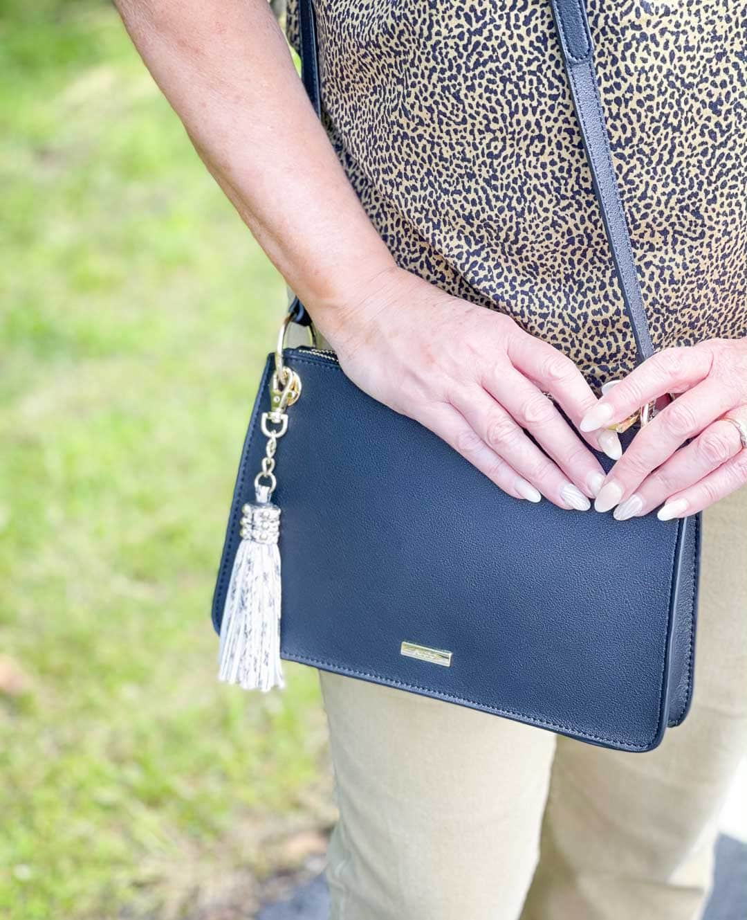 Over 40 Fashion Blogger, Tania Stephens is carrying a black handbag