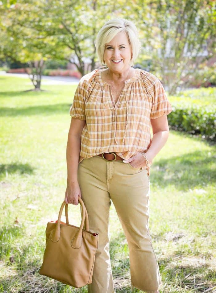 Over 40 Fashion Blogger, Tania Stephens, looks casual in her fall festive plaid top and pecan colored jeans