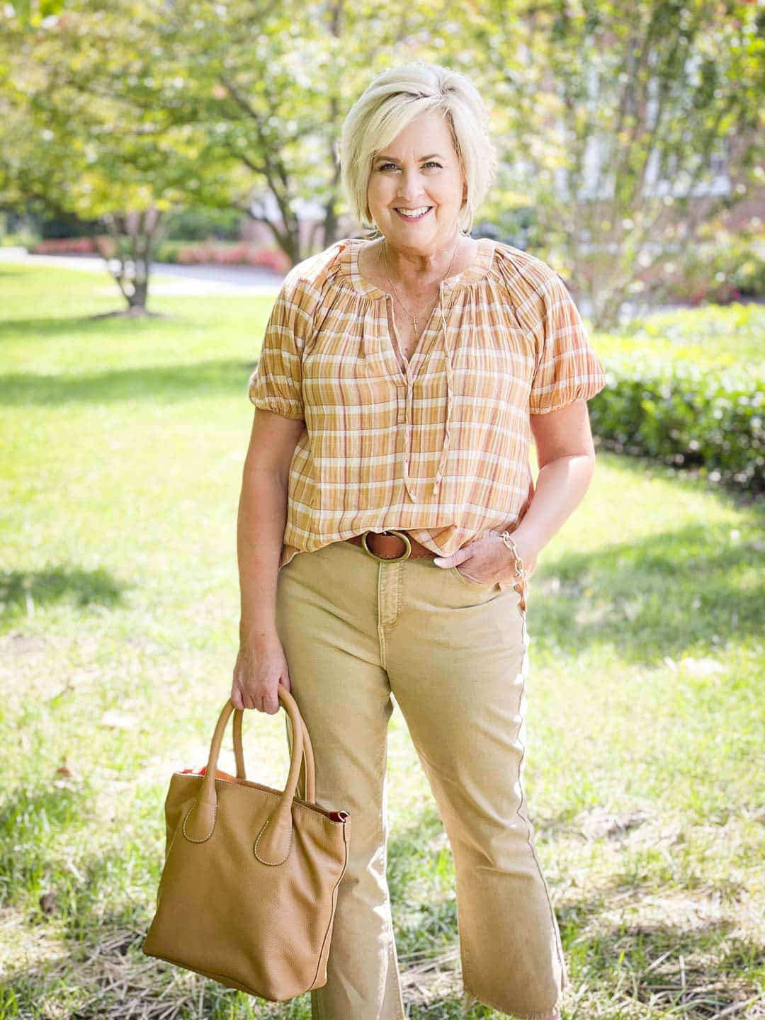 Over 40 Fashion Blogger, Tania Stephens, looks casual in her fall festive plaid top