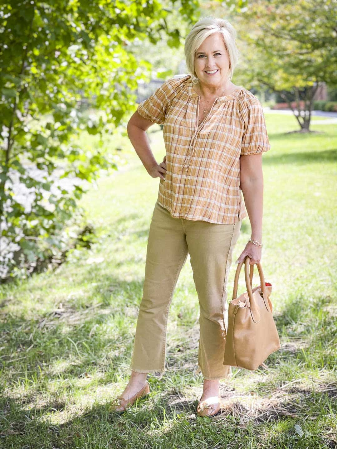 Over 40 Fashion Blogger, Tania Stephens, looks casual in her fall festive plaid top from Loft and cropped jeans