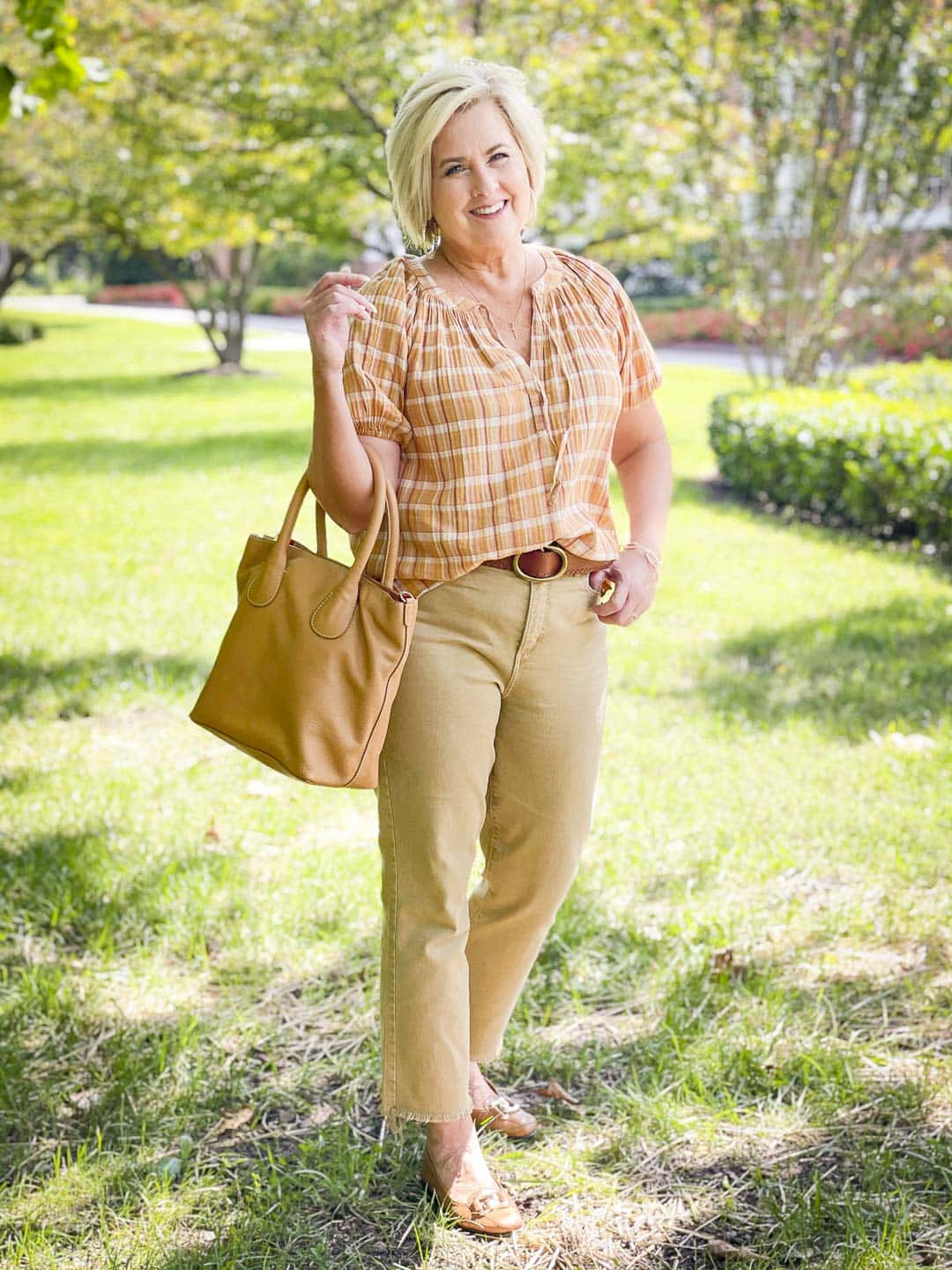 Over 40 Fashion Blogger, Tania Stephens, looks casual in her fall festive plaid top, cropped jeans, and flats