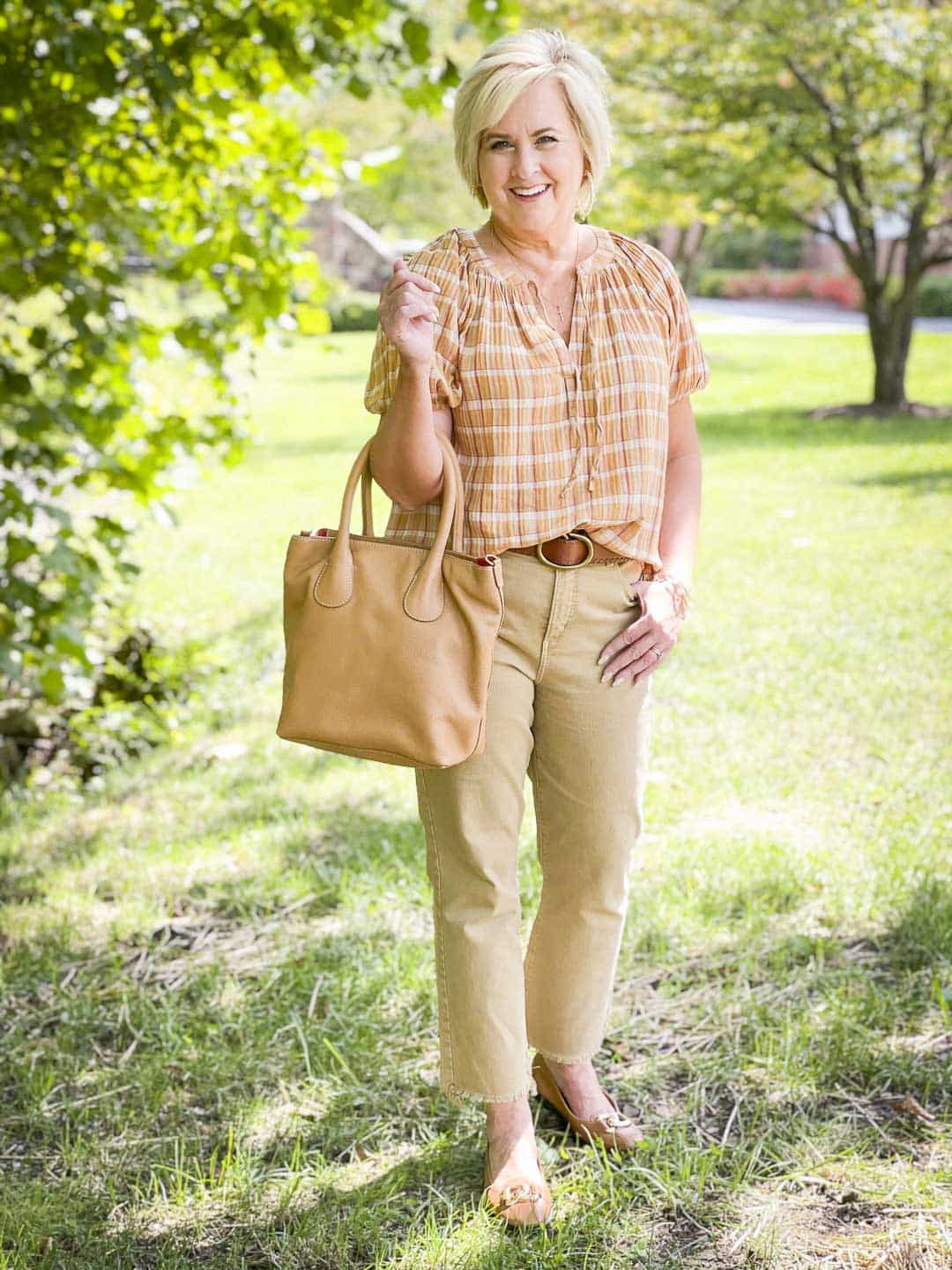 Over 40 Fashion Blogger, Tania Stephens, looks casual in her fall festive plaid top and cropped pecan colored jeans