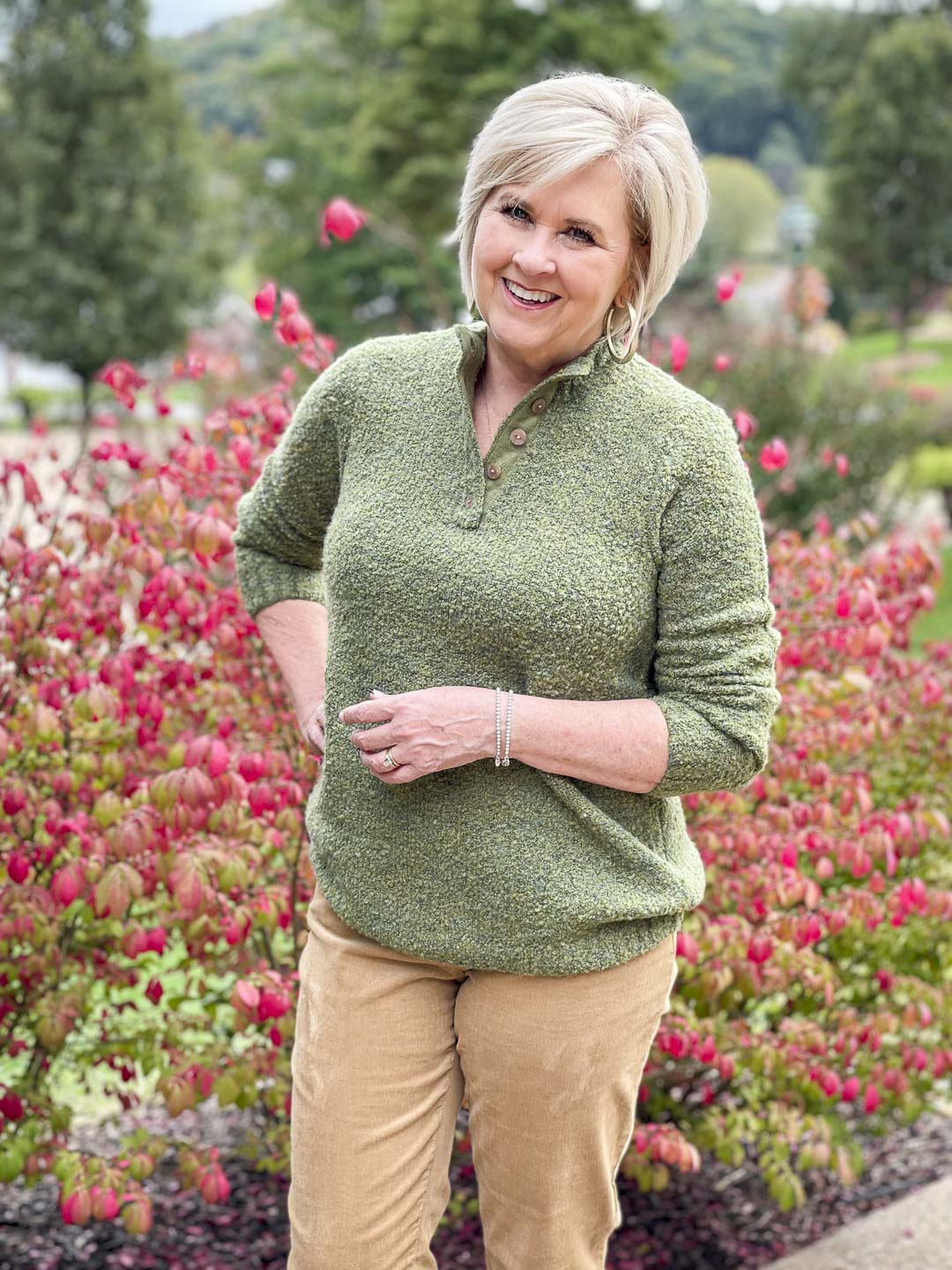 Over 40 Fashion Blogger, Tania Stephens is wearing a warm and cozy fall outfit of an olive green sweater