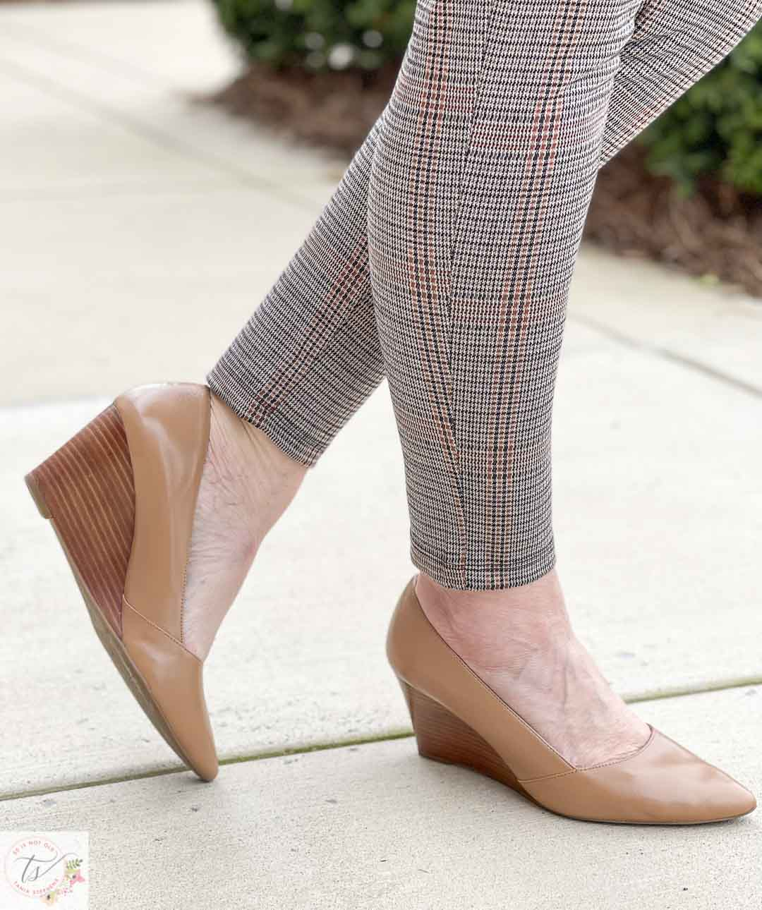Over 40 Fashion Blogger, Tania Stephens, is wearing taupe wedges and plaid pants