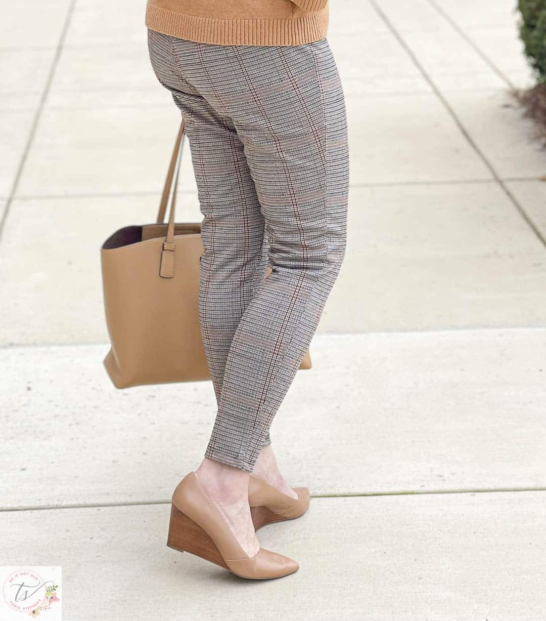 Over 40 Fashion Blogger, Tania Stephens, is wearing a pair plaid Ponte knit pants and taupe wedges