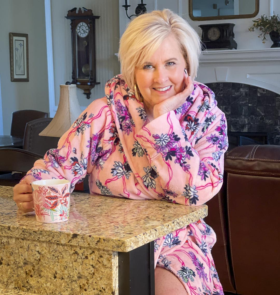 Over 40 fashion blogger, Tania Stephens is drinking a cup of coffee and staying warm on cold rainy mornings in a Hope Blooms Pink robe from Vera Bradley