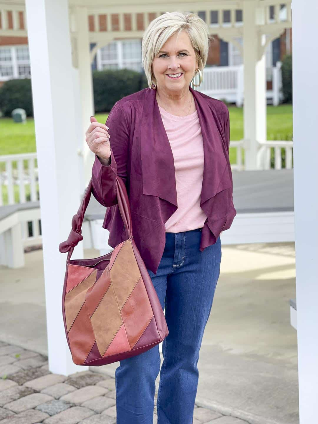 Over 40 Fashion Blogger, Tania Stephens, is showing her recent Walmart haul including this plum jacket, pink tee, and patchwork bag
