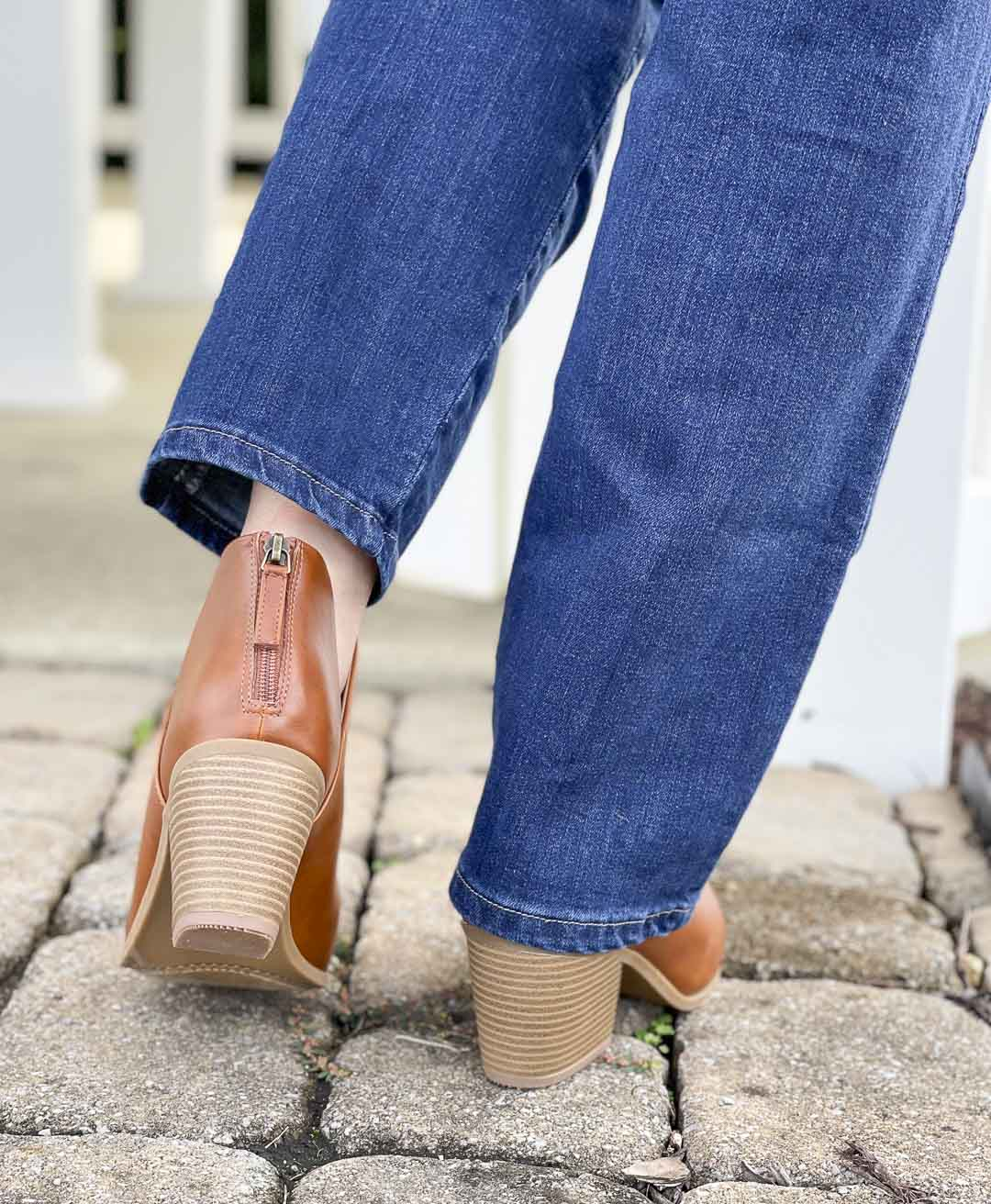 Over 40 Fashion Blogger, Tania Stephens, is showing her recent Walmart haul including these bootcut jeans and faux leather ankle boots