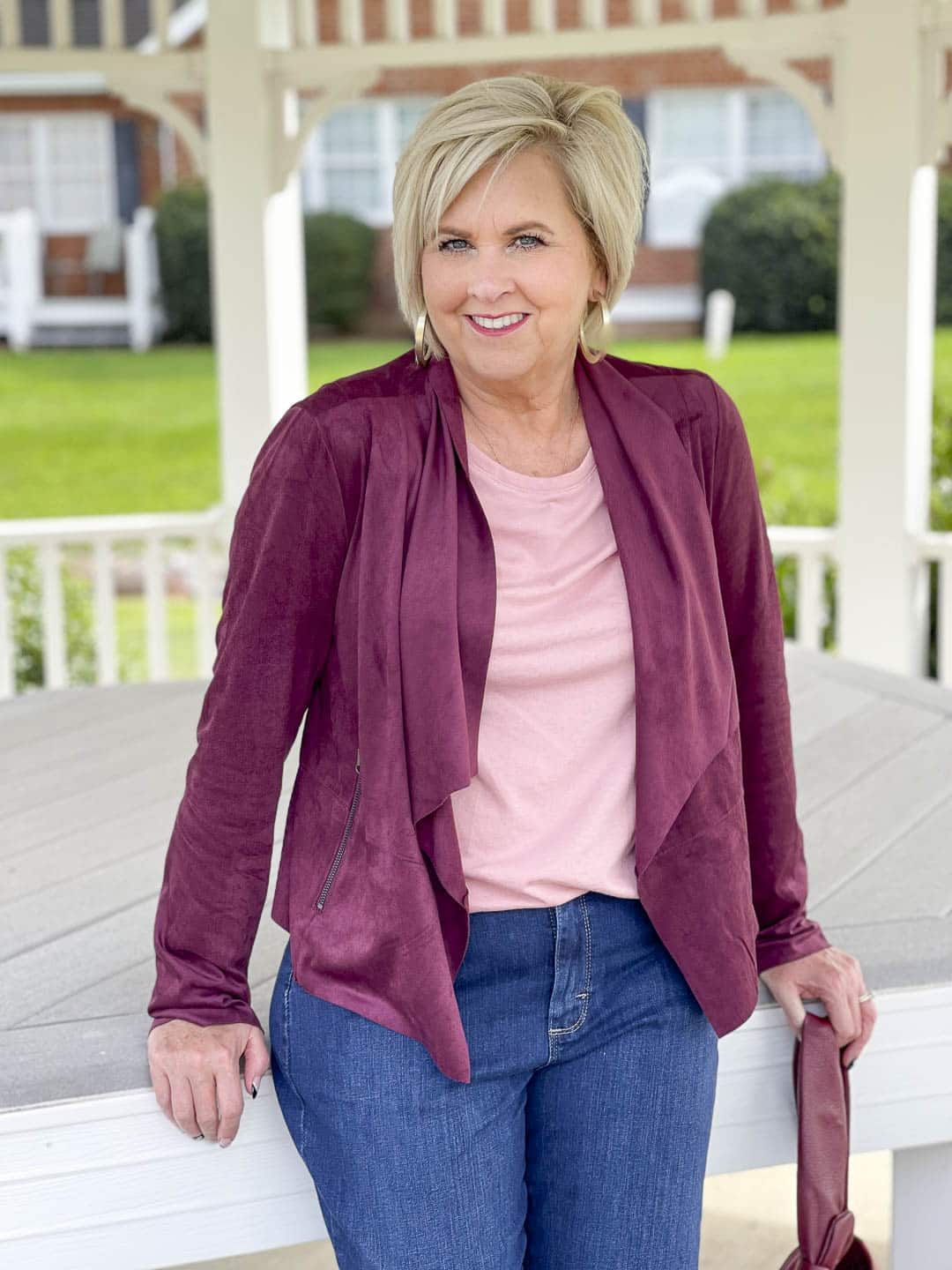 Over 40 Fashion Blogger, Tania Stephens, is showing her recent Walmart haul including this plum moto jacket and pink tee