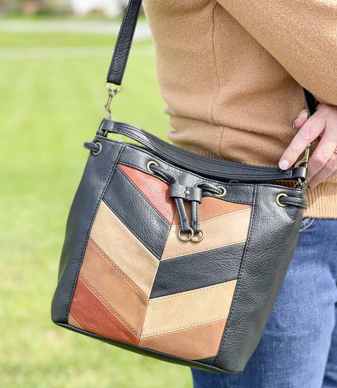 Over 40 Fashion Blogger, Tania Stephens, is showing her recent Walmart haul including this faux leather patchwork bag
