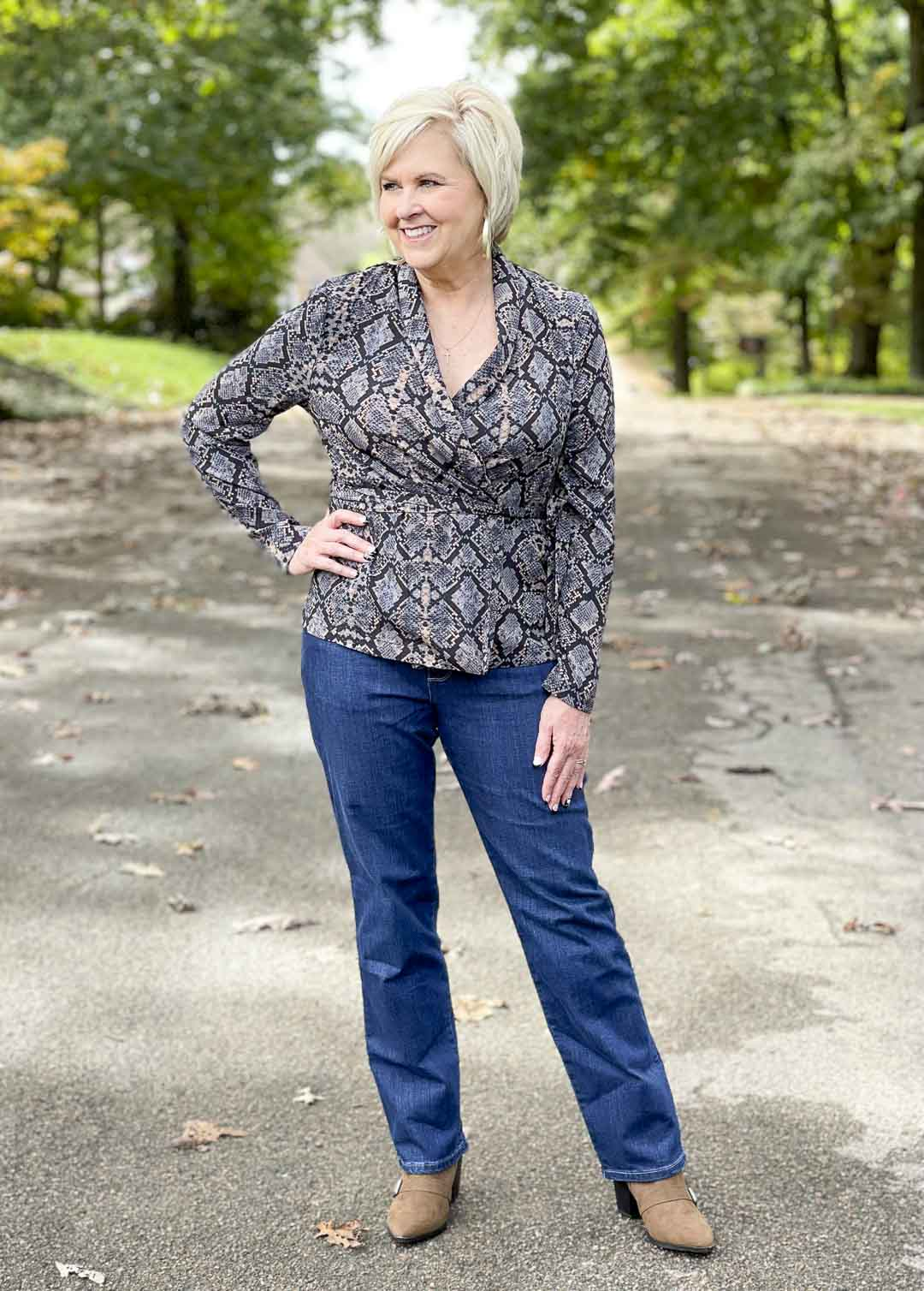 Over 40 Fashion Blogger, Tania Stephens, is showing her recent Walmart haul including this snake print wrap top and bootcut jeans