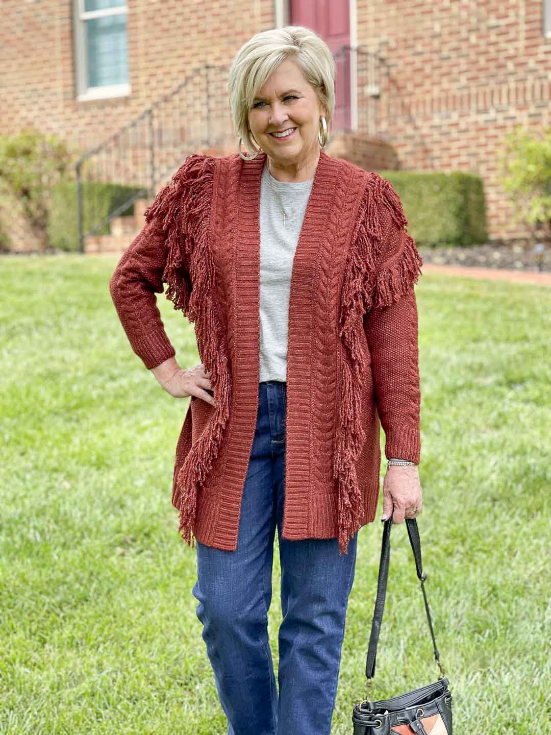 Over 40 Fashion Blogger, Tania Stephens, is showing her recent Walmart haul including this oversized fringed cardigan with a gray tee