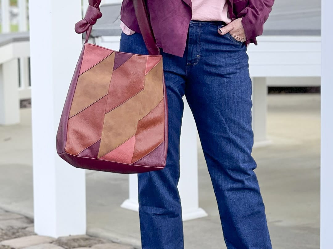 Over 40 Fashion Blogger, Tania Stephens, is showing her recent Walmart haul including these bootcut jeans and patchwork bag
