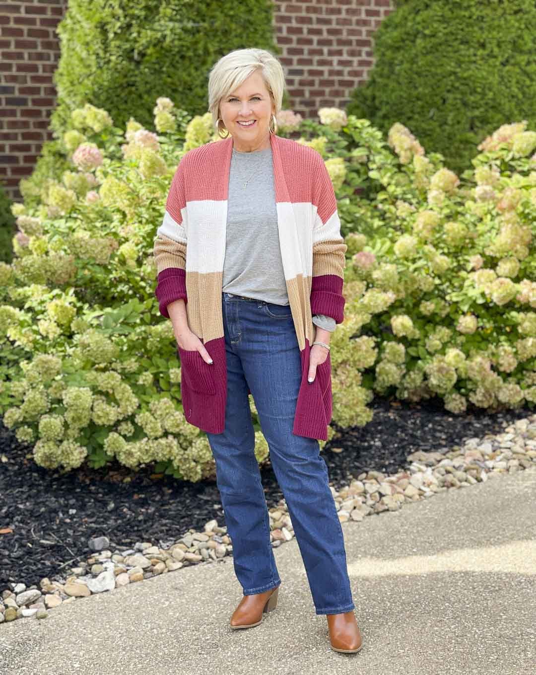 Over 40 Fashion Blogger, Tania Stephens, is showing her recent Walmart haul including this color blocked cardigan, bootcut jeans, and faux leather ankle boots