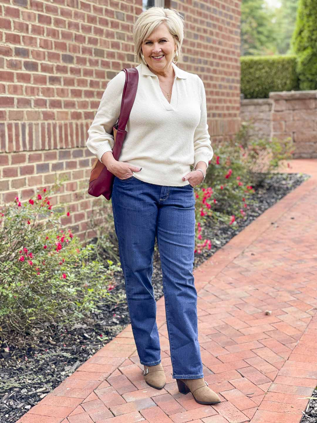 Over 40 Fashion Blogger, Tania Stephens, is showing her recent Walmart haul including this ivory polo sweater, bootcut jeans, and buckled ankle boots