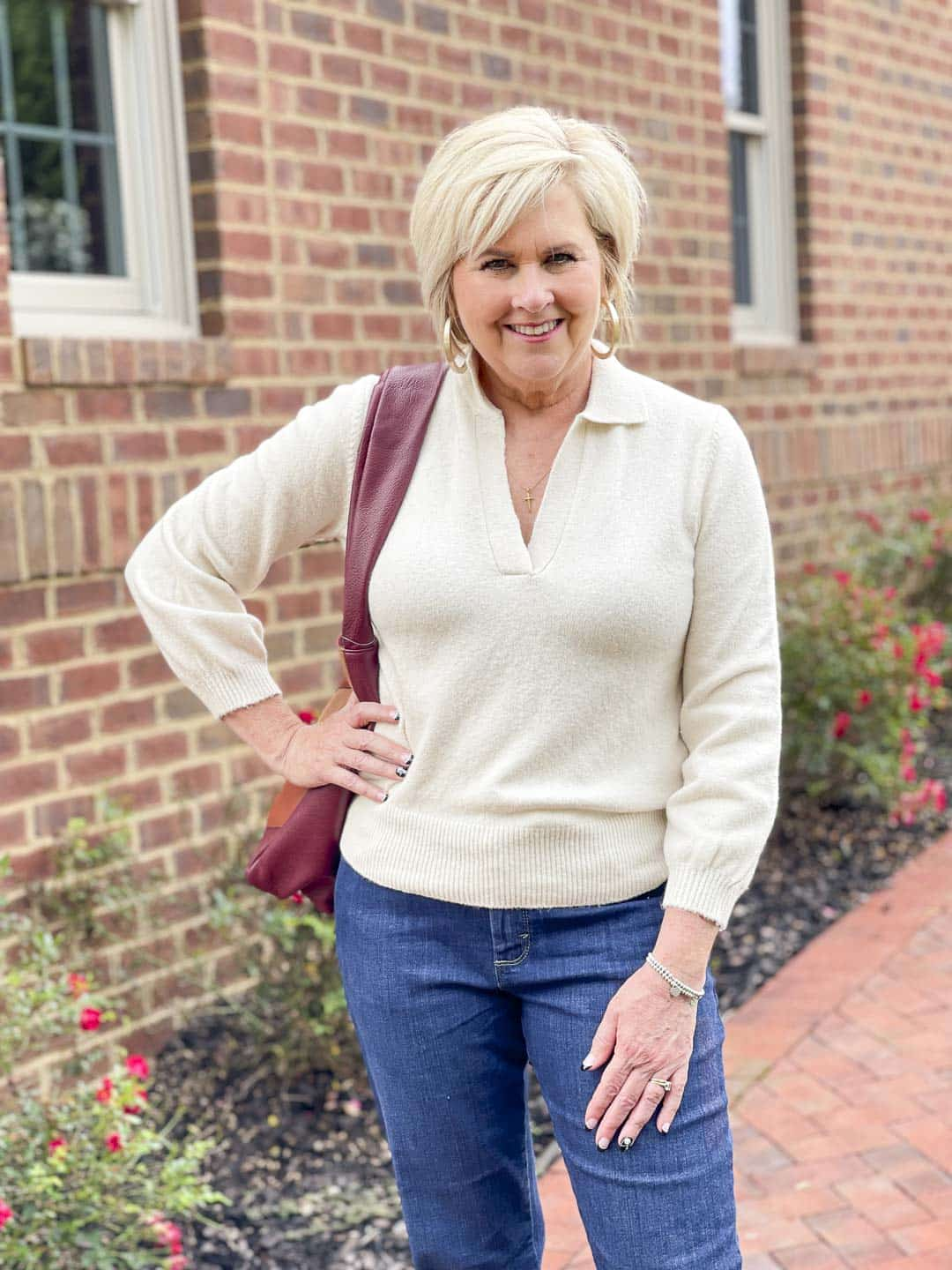 Over 40 Fashion Blogger, Tania Stephens, is showing her recent Walmart haul including this ivory polo sweater